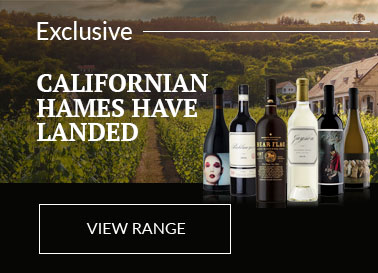 Range of exclusive Californian Wines displayed on a black platform in front of a scene of a Napa Valley vineyard.