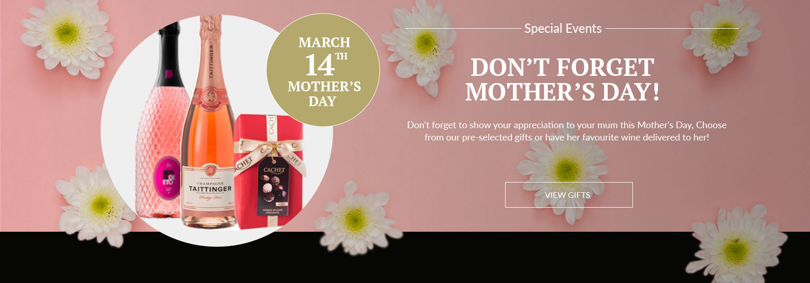 A selection of mother's day gifts, including champagne and chocolates in front of a pink background with daisies scattered on it.