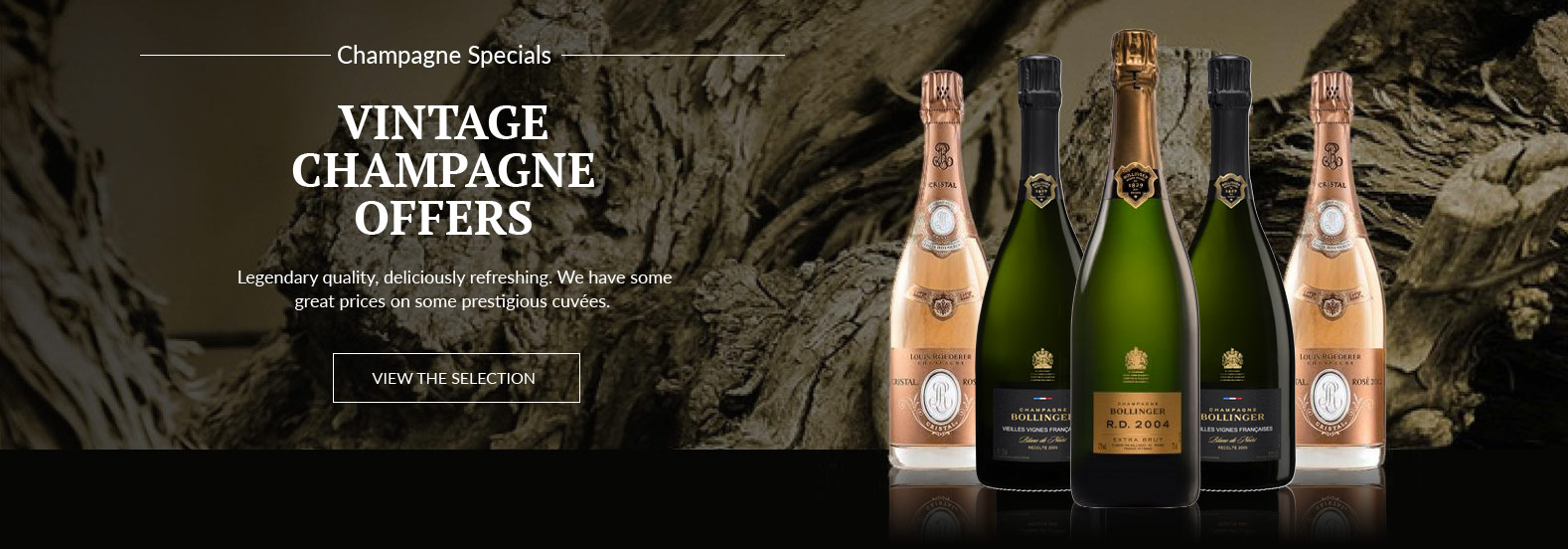 Image of vintage champagne bottles in front of a dramatic scene of ancient, curled wood.