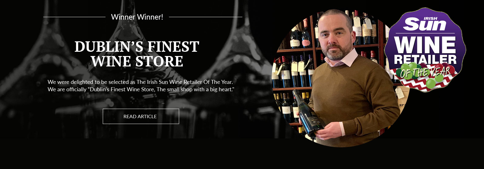 A picture of Paul holding a bottle of wine in the shop, overlaid with a plaque announcing their win as The Irish Sun Wine Retailer Of The Year.